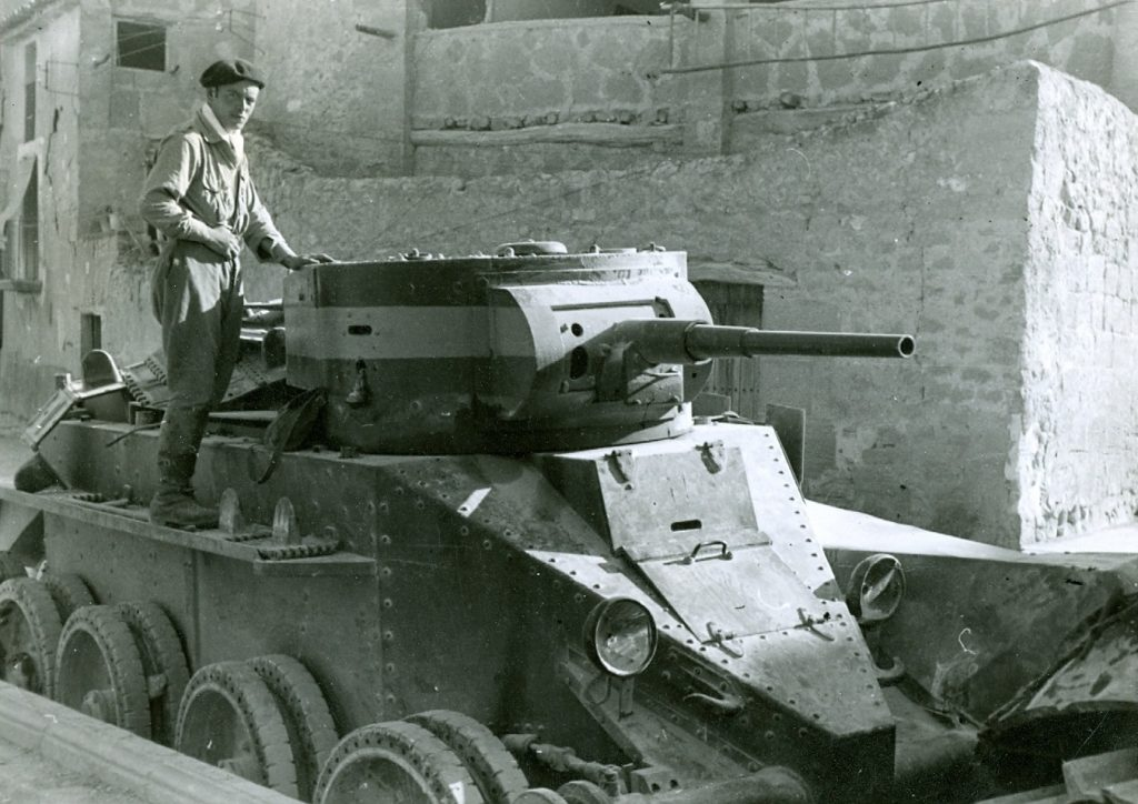 Spanish Civil War - Nationalist soldier with a captured Republican BT-5 BT-7 tank (Russian import)