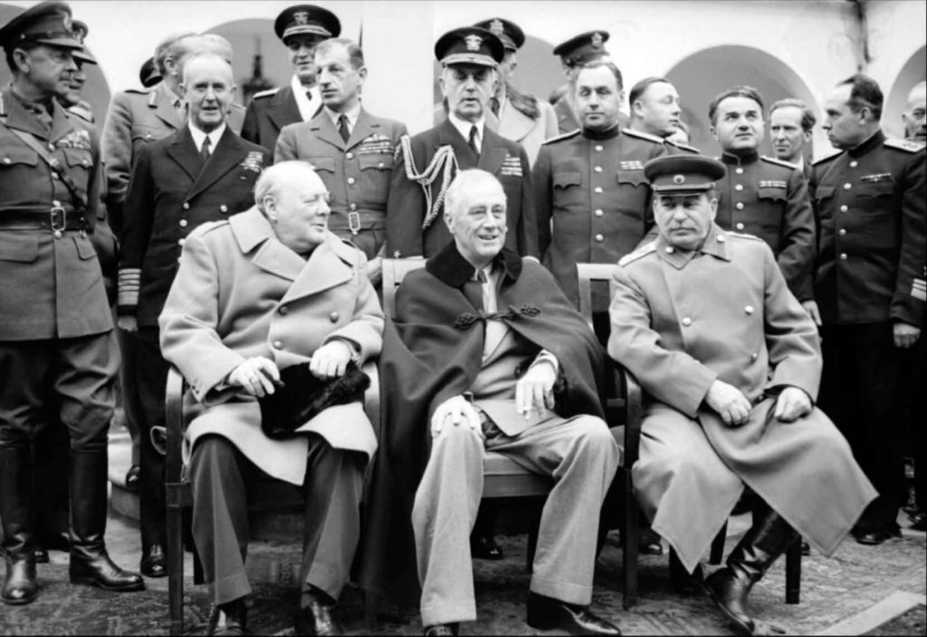 THE BIG THREE: Winston Churchill, Franklin D Roosevelt and Joseph Stalin sit for photographs during the Yalta Conference in February 1945.